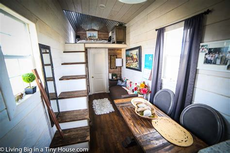 tiny house living room escapes rent with this 200 tiny home with big kitchen conscious