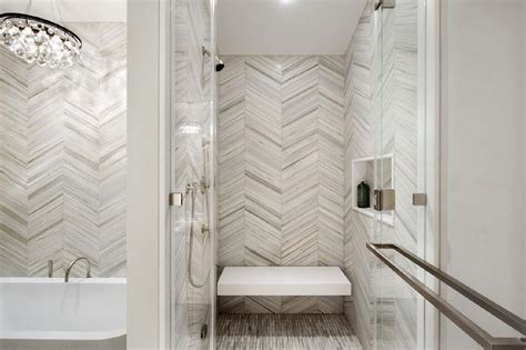 chevron bathroom ideas white and gray chevron shower tiles with floating shower bench contemporary bathroom