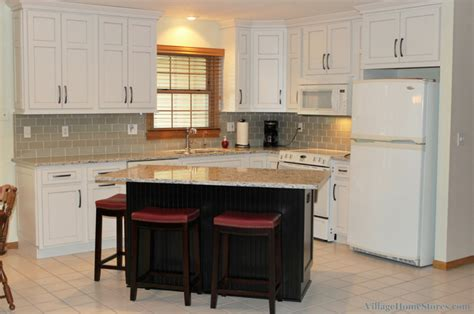 Replacing Kitchen Floor Without Removing Cabinets by White Painted Kitchen With Black Island Home Stores