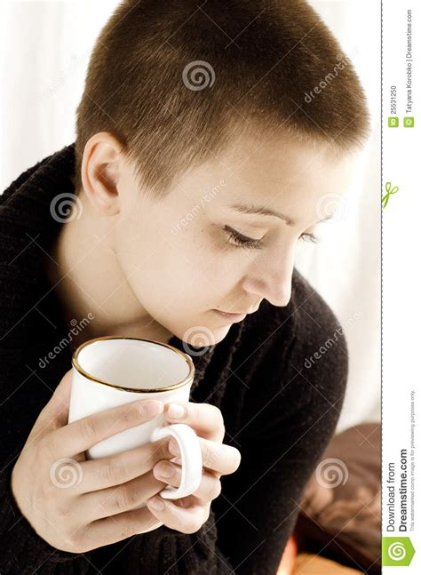 haircuts drink a girl with short haircut drinking tea stock photo image