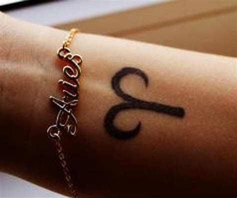 aries on back of neck aries symbol on wrist tattoos book 65 000 tattoos designs
