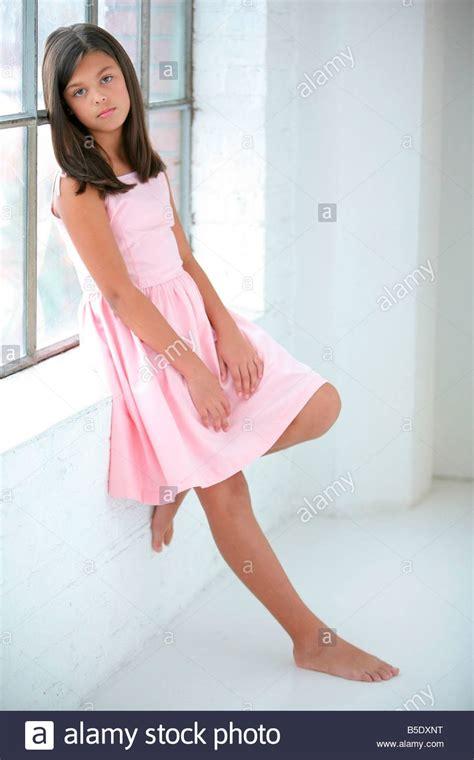 daisy model preteen preteen girl wearing a pink dress stock photo royalty