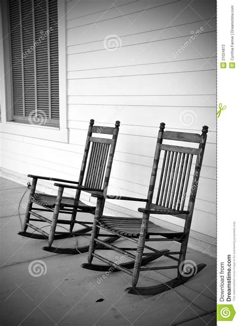 Black And White Rocking Chair by Rocking Chairs In Black And White Stock Photography