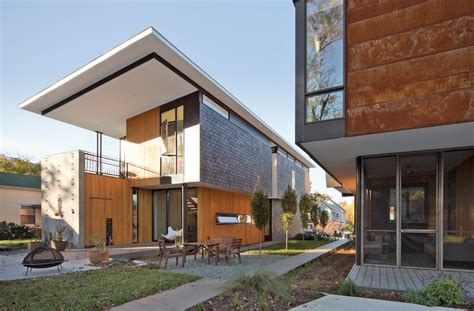 what is a contemporary home two compact modern homes fill challenging empty lots in an