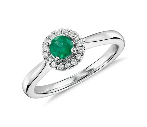 emerald and pav 233 halo ring in 14k