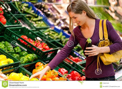 Time To Actually Buy Groceries by In Supermarket Buying Groceries Stock Photos Image