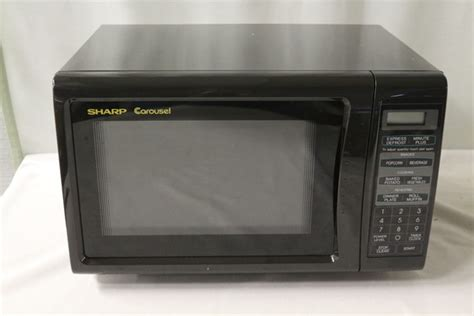 Microwave Sharp R 299in S sharp carousel black microwave model r 209bk