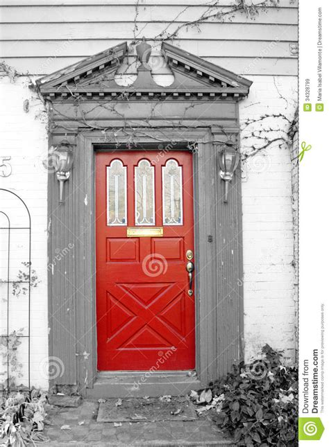 white house door red door with black and white background royalty free