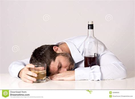 at desk businessman sleeping of whiskey at desk on clear