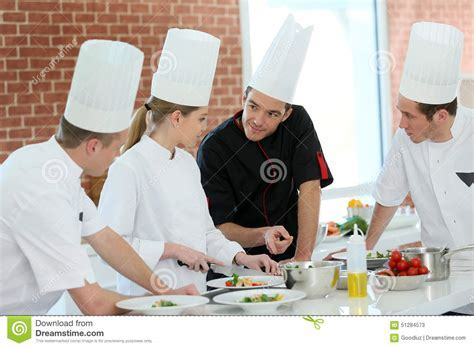 Group Of Students In Training Cooking Course Stock Photo