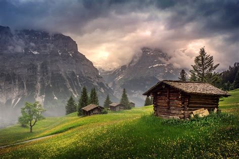 homes in the mountains switzerland mountains clouds houses wallpaper 2566x1715