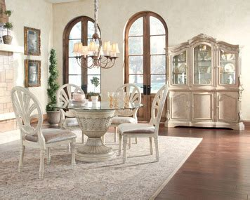 Ortanique Round Pedestal Table Dining Room Set By Ashley Ortanique Dining Room Set