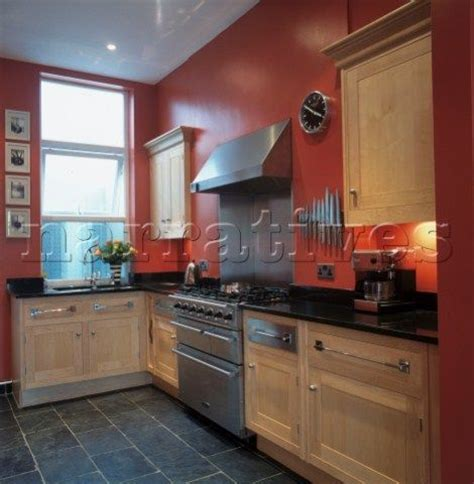 red kitchen walls with oak cabinets red painted kitchen walls google search slate floors