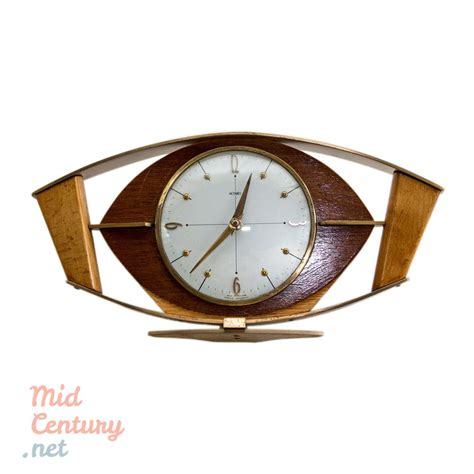 clock made of clocks metamec mantel clock made of wood and brass mid century