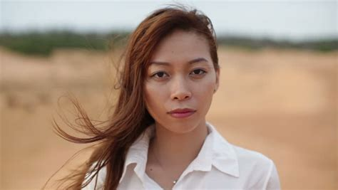 youngest looking women asian woman smile outdoor desert wind blowing hair wear