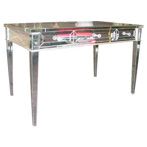 custom mirrored desk with silver leaf wood details
