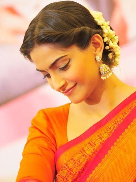 indian hairstyles with roses 3 middle parted twisted bun with mallige huvu in hair