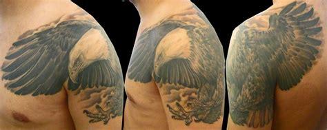 bald eagle tattoo on shoulder realistic eagle feather tattoo