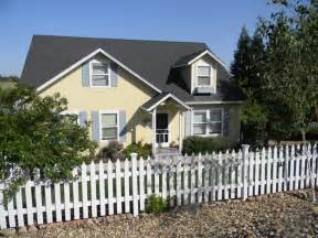 light yellow house yellow house and light blue grey shutters patio diy