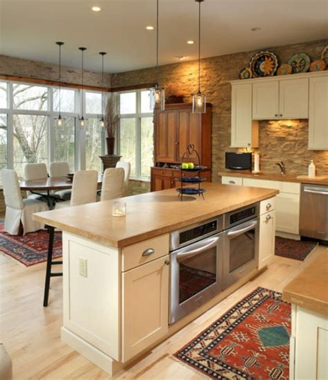 kitchen island with two side by side built in ovens for