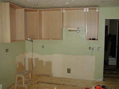 how to hang a kitchen cabinet hanging cabinets
