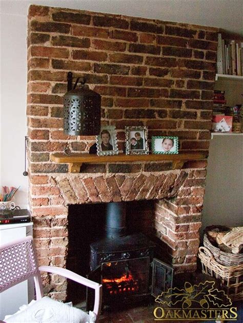 Small Brick Fireplaces by A Small Brick Fireplace With An Oak Mantle Shelf And