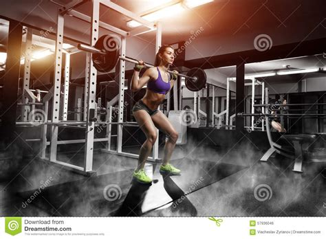 Barbel Fitness doing squat exercises with barbell stock photo image 57936046