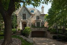 makow custom homes tudor rear elevation nice house rock and stone homes beautiful two story luxury brick