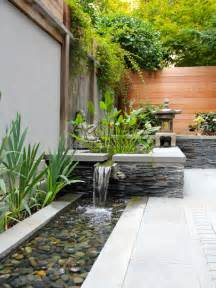 Asian Home Design Pictures example of a small courtyard patio design in dc metro with a fountain