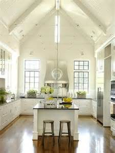 Vaulted ceiling and bead board reinforce the country meets cottage