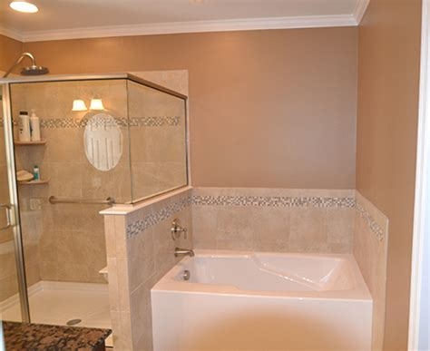 tiling side of bathtub glass and tile side by side in the master bathroom love