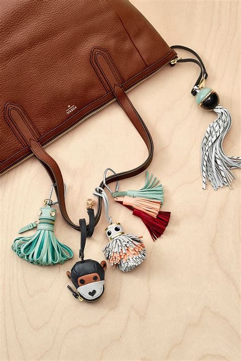 Fossil Monkey Bag Charm a neutral handbag like our sydney tote plus a colorful bag charm is the key to maste ring a