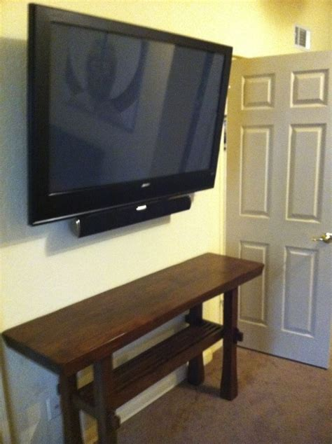 tv mounted in the bedroom with a soundbar mounted