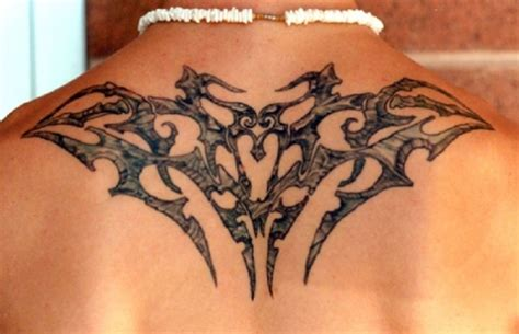 cool back tattoos for guys small tribal sun on back
