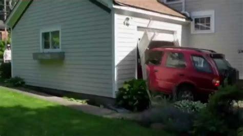 Car Crash Garage by 91 Year Crash Garage Door By Suv Car Granted