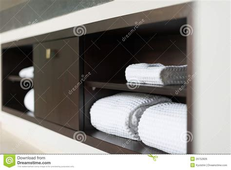 White Bathroom Wall Shelf - rolled white towels on shelf in hotel bathroom royalty free stock image image 29752826