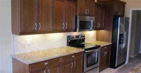 kitchen cabinets w crown moulding ron peters custom this transitional straight line kitchen layout features