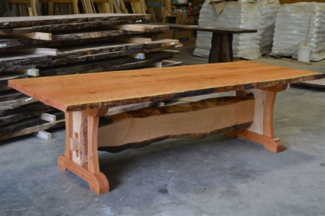 crafted live edge cherry dining table with live edge