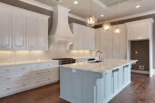 White Kitchen Cabinets With White Backsplash White And Silver Iridescent Tile Backsplash Transitional