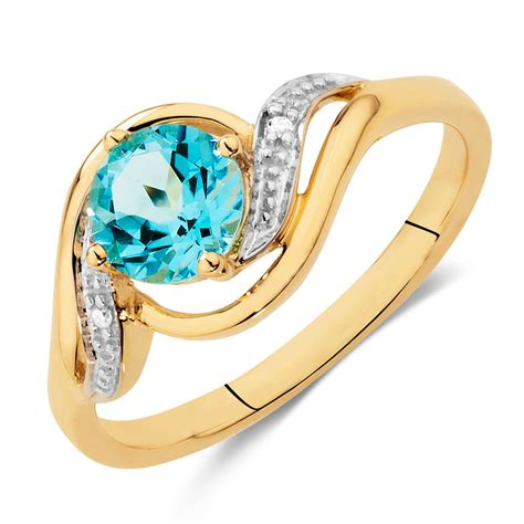 ring with blue topaz diamonds in 10ct yellow white gold