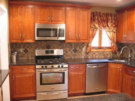 kitchen backsplash with oak cabinets and black appliances pinterest the world s catalog of ideas