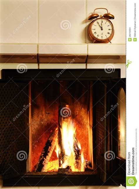 fireplace and fashioned copper alarm clock on the