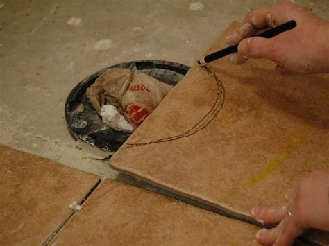 how to lay tile in a bathroom floor how to install tile on a bathroom floor hgtv