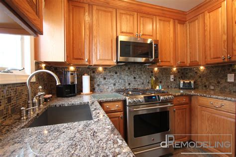 natural oak cabinets  glass mosaic backsplash traditional kitchen philadelphia