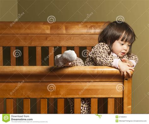 Toddler Climbing Out Of Crib by Climbing Out Of The Crib Stock Photography Image 27465812