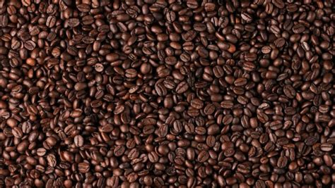 coffee seeds wallpaper hd wallpaper background roasted coffee beans falling and mixing with slow motion