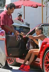 Karrueche Tran drives boyfriend Chris Brown's red Porsche