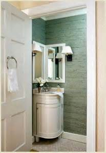 Adorable corner bathroom vanity and mirror aside small empire lamp