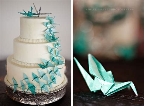 Origami Wedding Decor - aqua origami cranes cascading on classic wedding cake