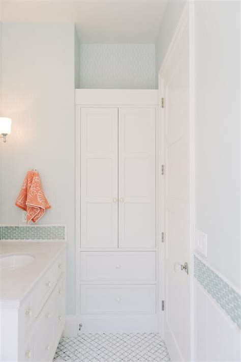blue kids bathroom with orange accents transitional